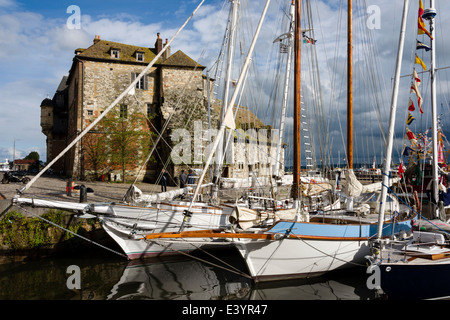 Sailboats docked in Vieux Bassin in front of La Lieutenance gatehouse from the 14th century, Honfleur, Normandy, - Stock Photo