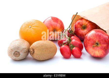 fruit and paper bag on white background - Stock Photo