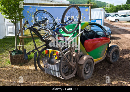 Muddy RENAULT TWIZY electric eco car with mountain bike rack at Hay Festival 2014 ©Jeff Morgan - Stock Photo