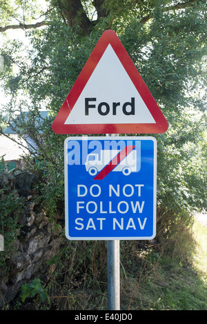 'Ford: Do Not Follow Sat Nav' warning sign in Morland village, Cumbria, UK - Stock Photo