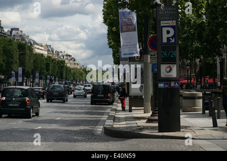 Traffic on Avenue des Champs Elysees Paris - Stock Photo
