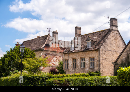 cotswold stone houses on a beautiful street in cirencester, heart of the cotswolds - Stock Photo
