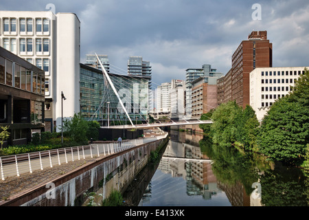 Manchester, UK. The Lowry Hotel and Trinity Bridge over the River Irwell between Salford and Manchester - Stock Photo