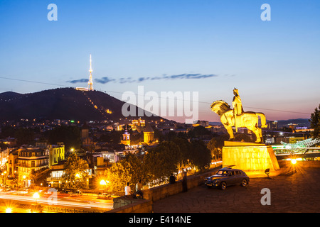 Equestrian statue of King Vakhtang Gorgasali at dusk, Tbilisi, Georgia - Stock Photo