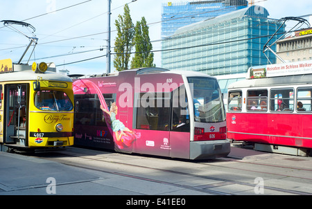 Trams at a tram stop Vienna. With 172 km total length, Vienna Tram network is among the largest in the world. - Stock Photo