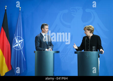 Berlin, Germany. 2nd July, 2014. German Chancellor Angela Merkel (R) and NATO Secretary General Anders Fogh Rasmussen - Stock Photo