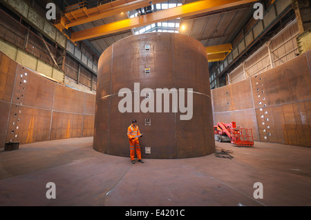 Engineer inspecting marine fabrication used for cable laying - Stock Photo