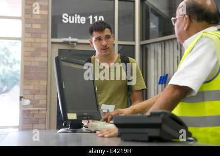 Male US Citizen tearfull at bus station trying to locate his common law wife and child being brought illegally into - Stock Photo