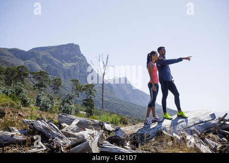 Young joggers enjoying view from hilltop - Stock Photo