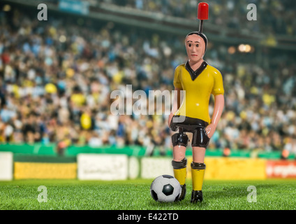 Digitally generated image of soccer player with ball in stadium - Stock Photo