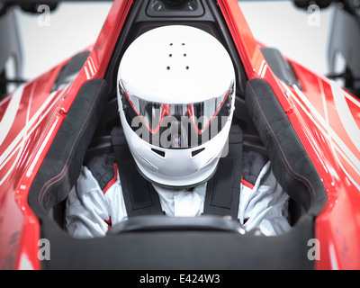 Racing driver wearing crash helmet in supercar - Stock Photo