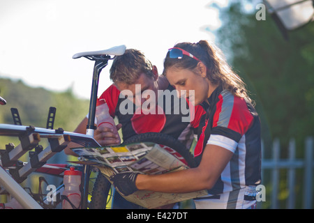 Cyclists reading map - Stock Photo
