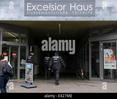 Berlin, Germany. 02nd July, 2014. Police officers walk into the Excelsior Haus on Stresemannstraße in Berlin, Germany, - Stock Photo