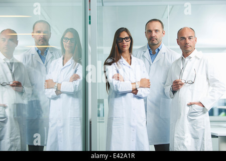 Doctors posing for camera - Stock Photo