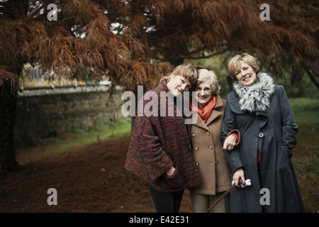 Portrait of senior woman, daughter and granddaughter - Stock Photo
