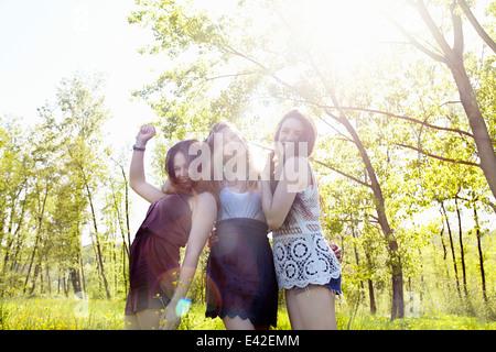 Three female friends in sunlight, portrait