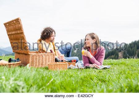 Mid adult couple enjoying picnic, Wallberg, Tegernsee, Bavaria, Germany - Stock Photo