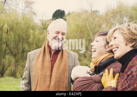 Three generation family laughing - Stock Photo