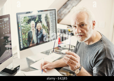Senior man working at home - Stock Photo
