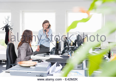 Female office workers in office - Stock Photo