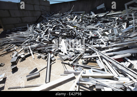 Heap of aluminium parts in scrap yard - Stock Photo