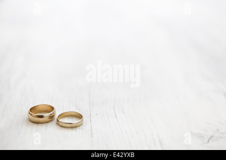 Still life of his and hers wedding rings - Stock Photo