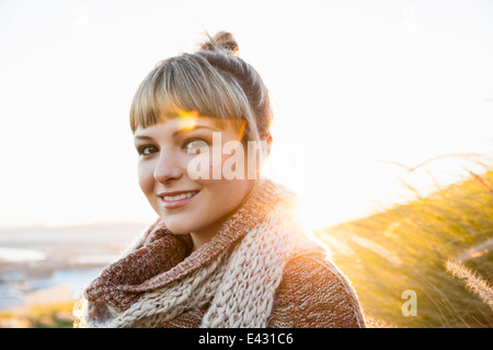Portrait of young woman in sunlit marsh