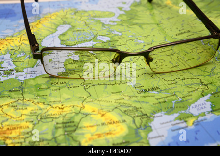 glasses on a map of europe - Stock Photo