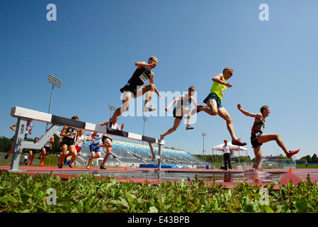 Competitors in the men's 3000-meter steeplechase at the Canadian Track & Field Championships June 28, 2014 in Moncton. - Stock Photo