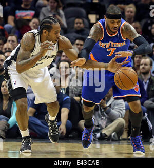 Jan 2, 2014 - San Antonio, Texas, U.S. - KAWHI LEONARD reaches in trying to make a steal from CARMELO ANTHONY as - Stock Photo