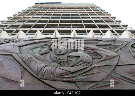 A bas relief sculpture featuring a cosmonaut on a building near Alexanderplatz in Berlin, Germany. - Stock Photo