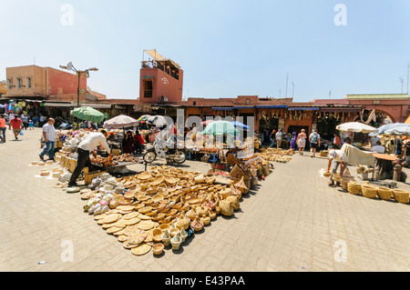 Handbags and leather goods at the outdoor section of the Jemaa El-Fna El-Fnaa (Big Square) souq, Marrakech, Morocco - Stock Photo