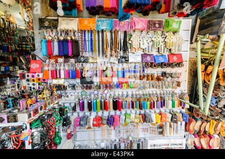 Lots of goods for sale at the souk in Marrakech, Morocco - Stock Photo