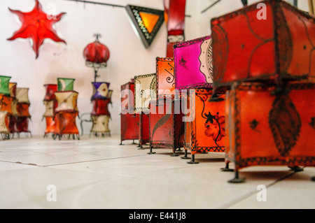 Lampshades and lanterns made from coloured goat skin on metal frames, on sale at the Souq in Marrakech, Morocco. - Stock Photo