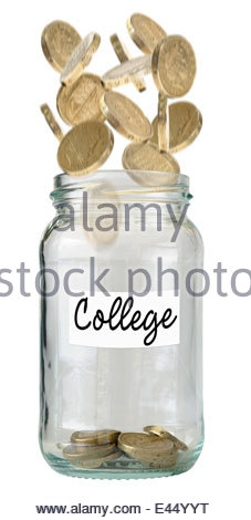 British One Pound coins falling into savings jar for college fund, Dorset, England, UK - Stock Photo