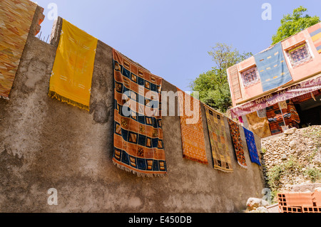 Moroccan handmade rugs for sale in a rural village in the Atlas Mountains, Morocco - Stock Photo