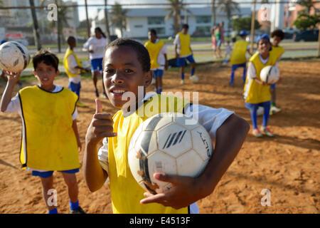 Brazilian boy with soccer ball in a social project of the Deutsche Gesellschaft für Internationale Zusammenarbeit, - Stock Photo