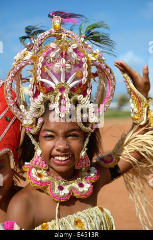 Dancer, colourfully dressed girl of a traditional Afro-Brazilian musical group, Salvador da Bahia, Bahia, Brazil - Stock Photo