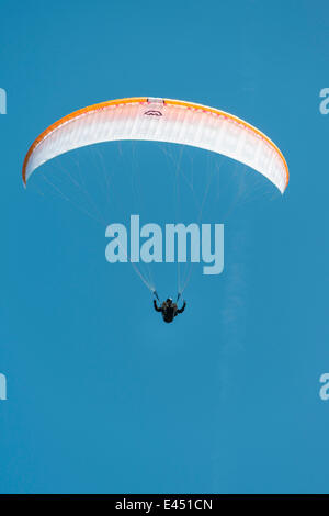 Paraglider against a blue sky - Stock Photo