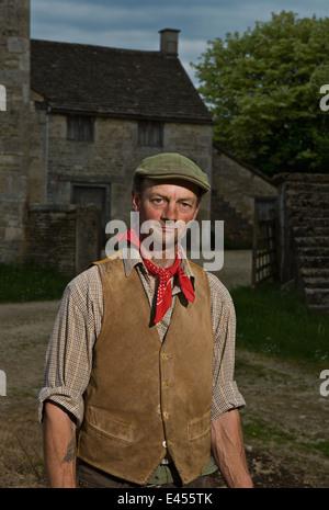 Portrait of mature traditional farmer in farmyard - Stock Photo