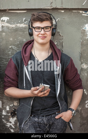 Teenage boy with headphones and smartphone - Stock Photo