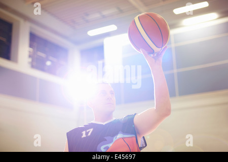 Wheelchair basketball player aiming ball - Stock Photo