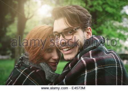 Couple wrapped in blanket - Stock Photo