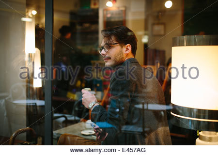 Man sitting in cafe - Stock Photo