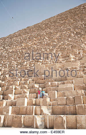 Mother and sons, tourists at The Great Pyramid of Giza, Egypt - Stock Photo