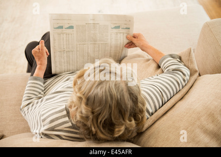 Senior woman reading the newspaper - Stock Photo