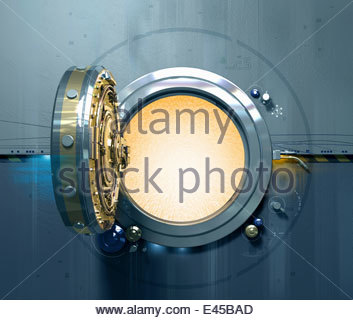 Open vault door with glowing light inside - Stock Photo