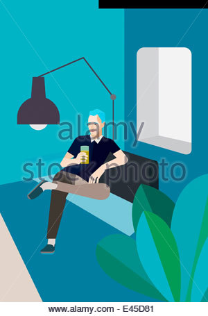 Man relaxing on sofa with drink - Stock Photo