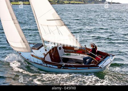 Woman sailing yacht 'Starry Night' off Newport, Rhode Island, USA. 2009. - Stock Photo