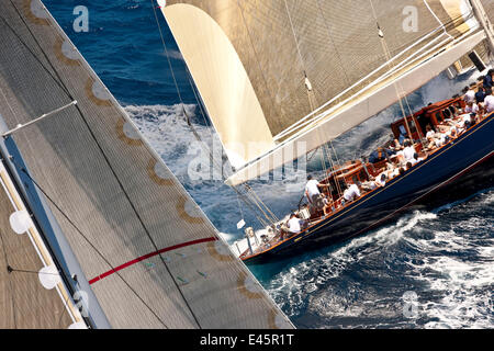 J-Class 'Velsheda' leading another yacht at the Panerai Antigua Classic Yacht Regatta, Caribbean, April 2010. - Stock Photo